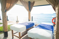 Massage bed by the beach Royalty Free Stock Image