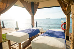 Massage bed by the beach Royalty Free Stock Photography