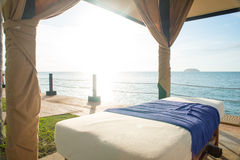 Massage bed by the beach Stock Photos