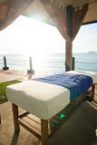 Massage bed by the beach Stock Photography