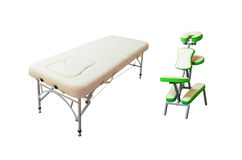 Massage bed and chair. Isolated on white background stock photos