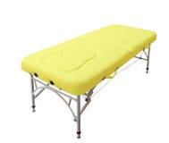 Massage bed. Isolated on white background stock photography