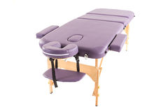 Massage bed on the white background Stock Photography