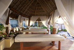 Massage beds. Set of massage beds under a ropical roof Stock Images