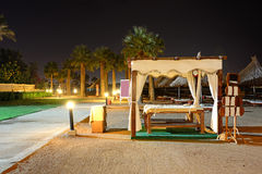 The massage beds on the beach in night illumination Royalty Free Stock Images