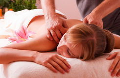 Massage body. Beatiful woman relax in spa stock photos
