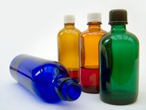 Massage bottles. Glass bottles containing oils for massahe therapy Stock Photography