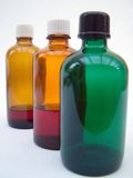 Massage bottles. Glass bottles containing oils for massage Stock Photos