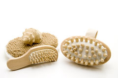 Massage brush. And hairbrush with sea shell Royalty Free Stock Images