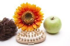 Massage brush with apple Stock Image