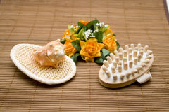 Massage brush with bouquet Royalty Free Stock Photography