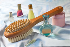 Massage brush and conditioning agents behind a body. royalty free stock photography