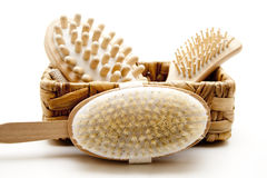 Massage brush with hairbrush in the basket Royalty Free Stock Images