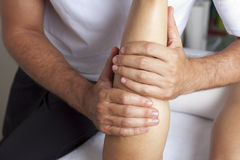 Massage of calf muscle Royalty Free Stock Image
