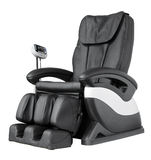 Massage Chair. Black leather comfortable reclining massage chair. With Shiatsu, Tapping and Kneading therapeutic massages stock photo