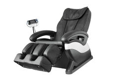 Massage Chair. Black leather comfortable reclining massage chair. With Shiatsu, Tapping and Kneading therapeutic massages stock image