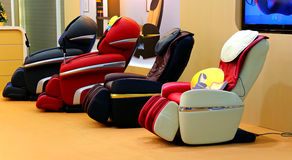 Massage chairs Stock Images