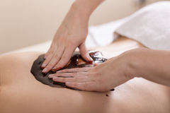 Massage with chocolate Royalty Free Stock Photography