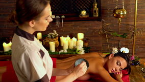 Massage and clay body mask in spa salon. 4k stock footage
