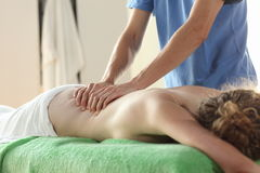 Massage - close up. Woman relaxing while getting a back massage Stock Photo