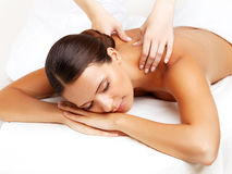 Massage. Close-up of a Beautiful Woman Getting Spa Treatment Stock Photos