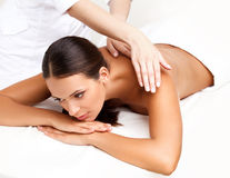 Massage. Close-up of a Beautiful Woman Getting Spa Treatment Royalty Free Stock Photography
