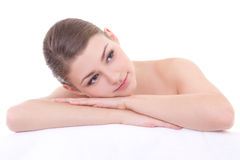 Massage concept - young beautiful woman lying on towel and relax Stock Photography