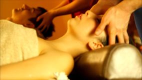 Massage for couple in the warm atmosphere of the salon