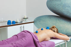 Massage with cupping glass in beautician Royalty Free Stock Images