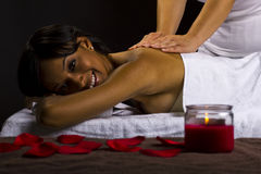 Massage in a dark room Royalty Free Stock Photography