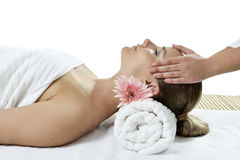 Massage at the day spa. Young woman lying on massage table at spa. closed eyes Stock Photo