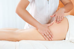 Massage de cuisses Photo libre de droits