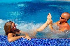 Massage de pied dans le jacuzzi Photo stock