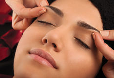 Massage eyebrows Stock Image