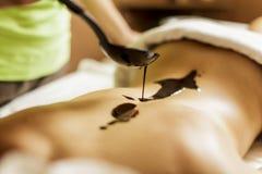 Massage för varm choklad arkivbilder