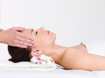 Massage for the face. Of young beautiful woman - horizontal Stock Images