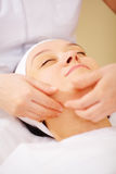 Massage of face at beauty treatment salon Royalty Free Stock Photo