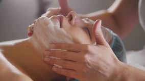 Massage for face skin - spa salon skincare. Close up Royalty Free Stock Photography