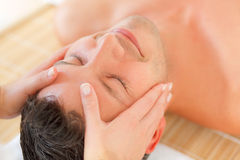 Massage face wellbeing treatment Stock Photography