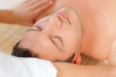 Massage face wellbeing treatment. Relaxing man enjoying wellbeing wellness spa therapy Stock Images