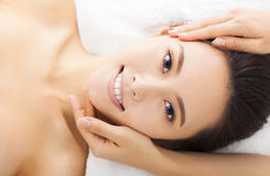 Massage of face for woman in spa Stock Photos