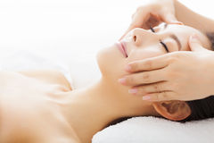 Massage of face for woman in spa. Salon Stock Photos