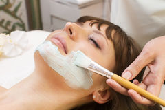 Massage and facial peels. At the salon cosmetics Stock Photos