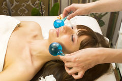 Massage and facial peels. At the salon cosmetics Stock Images
