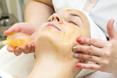 Massage and facial peels. At the salon cosmetics Royalty Free Stock Photography