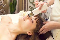 Massage and facial peels Stock Photos