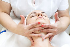 Massage and facial peels. At the salon cosmetics Stock Photography
