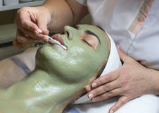 Massage and facial peels. At the salon cosmetics Stock Image