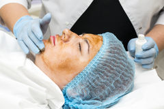 Massage and facial peels. At the salon cosmetics Royalty Free Stock Photo
