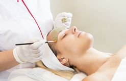 Massage and facial peels at the salon Royalty Free Stock Images